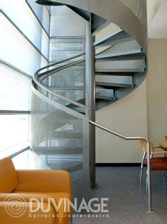 Custom Metal Spiral Staircases by Duvinage with Wood and