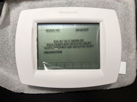 Honeywell TH8110U1003 VisionPro Thermostat Operating Manual