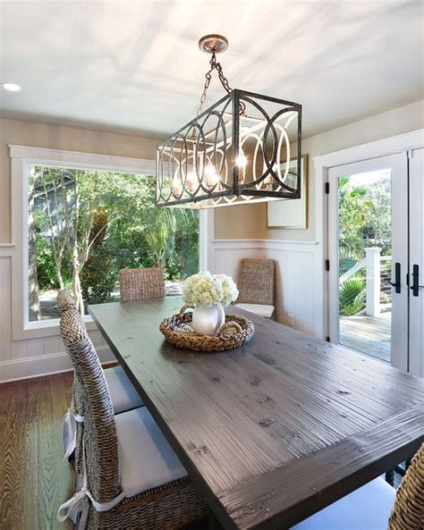 How high to hang a chandelier over a dining room table