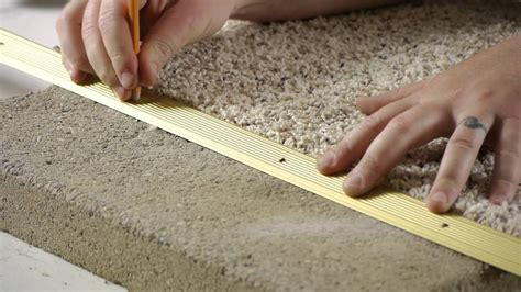 How to Attach Transition Strip Over Carpet on Concrete