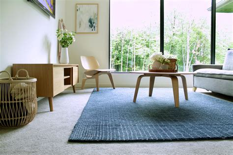 How to Lay an Area Rug Over Carpet The Spruce