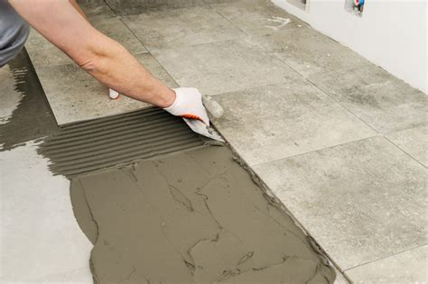 How to Prepare for Laying Tile Over a Concrete Floor