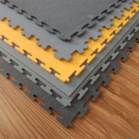 Interlocking plastic floor tiles and plastic floor mats