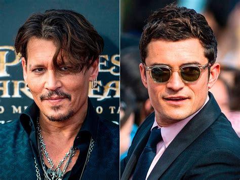 Johnny Depp and Orlando Bloom Reunite on Pirates Red Carpet