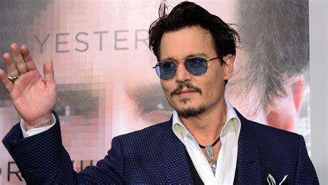 Johnny Depp flies solo at Transcendence red carpet