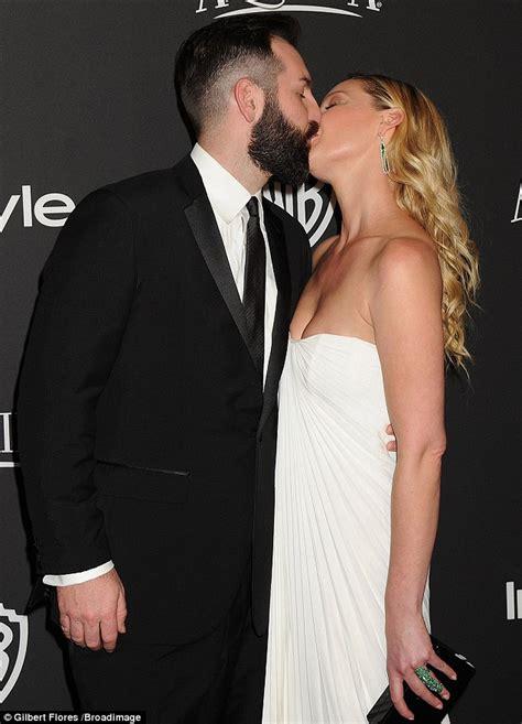Katherine Heigl and husband Josh Kelley kiss on the red