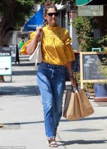 Katie Holmes looks hippie chic in peasant blouse and Levis