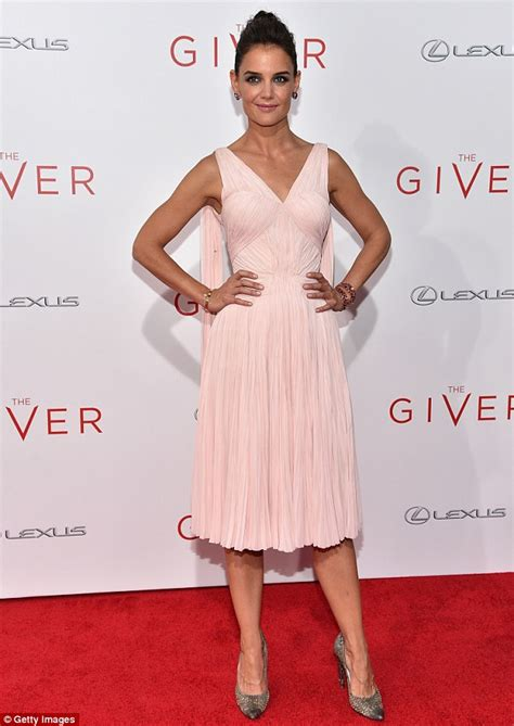 Katie Holmes takes command of the red carpet in pale