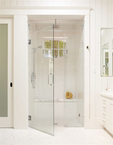 Large white tile shower with bench steam shower and