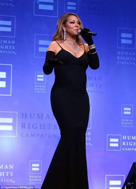 Mariah Carey Flaunts Her Curves in Figure Hugging Dress
