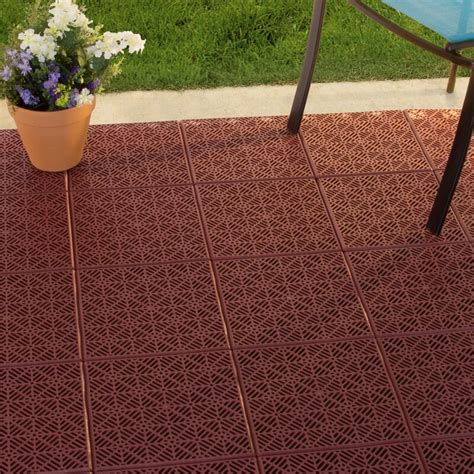 Plastic interlocking floor tiles for patio decking