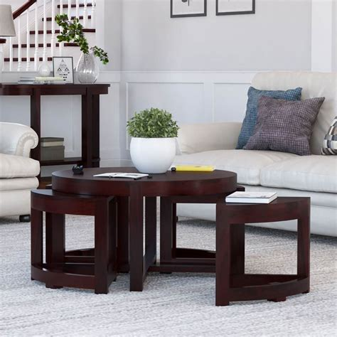 Round coffee table with 4 nesting wedge ottomans