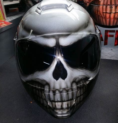 Some examples of motorcycle helmets FlamesOnMyTank
