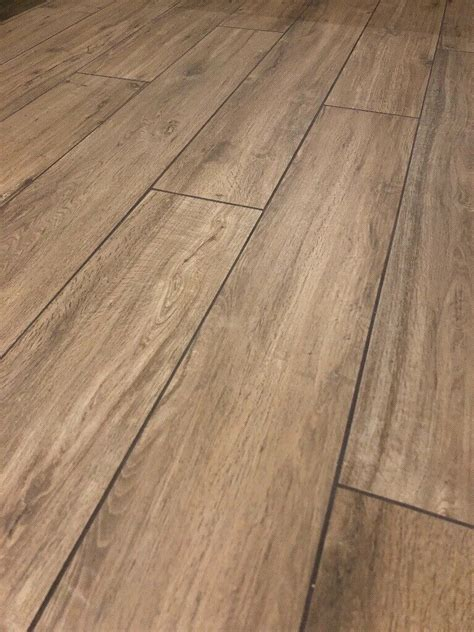 Tiles in ceramics Coverings with wood and stone effect