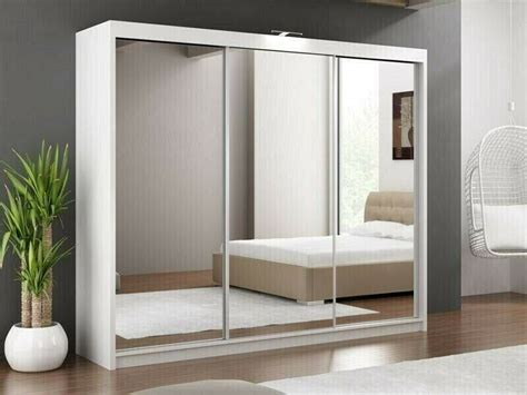 Wardrobes white slider mirrored Furniture Village