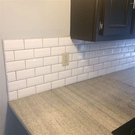 What is the rationale for grey grout with white subway tile